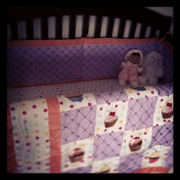 Cupcake crib bedding with dolls from abuela (my mom)